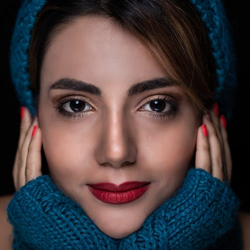 woman-with-blue-knit-glove-on-portrait-photography-3690696-min